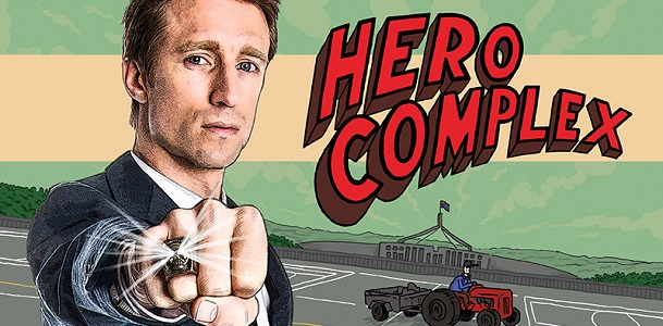 A cartoon of Sammy J standing outside of Parliament House with words 'Hero Complex'